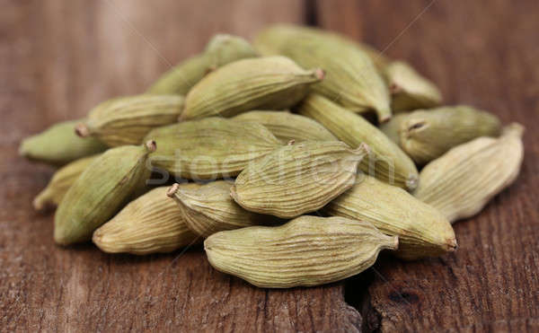 Cardamom seed on wooden surface Stock photo © bdspn