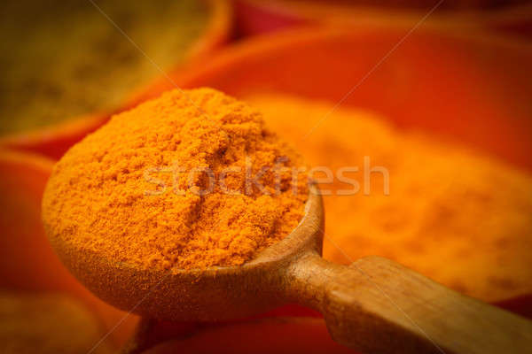 Ground turmeric in a spoon Stock photo © bdspn