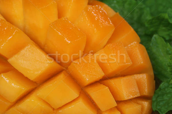 Sliced mango with green mint Stock photo © bdspn