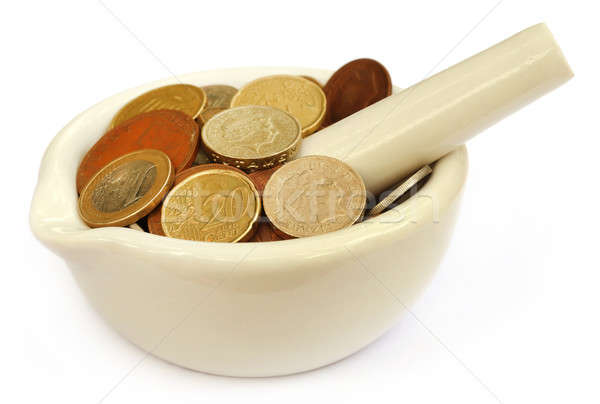 Coins in a mortar with pestle Stock photo © bdspn