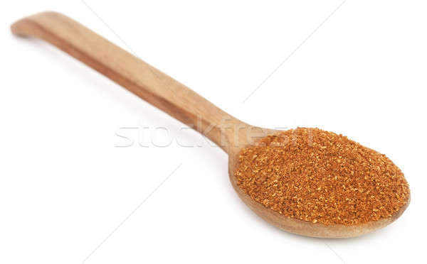 Crushed cumin in a wooden spoon Stock photo © bdspn