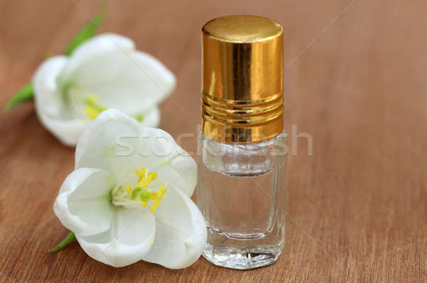 Dwarf White Orchid with bottle of extract Stock photo © bdspn