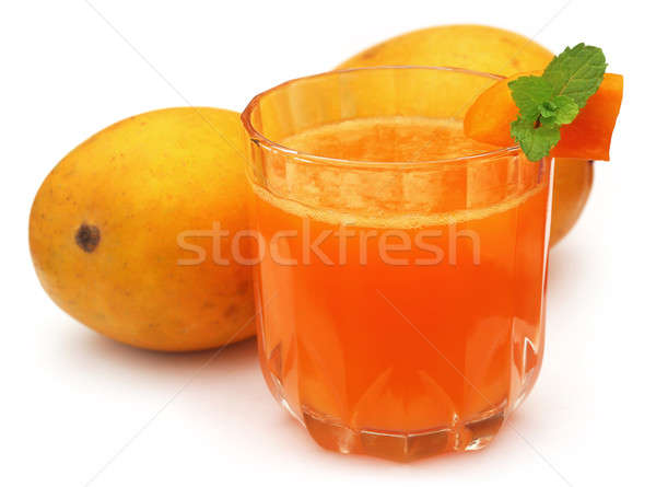 Mango juice with sliced fruit Stock photo © bdspn