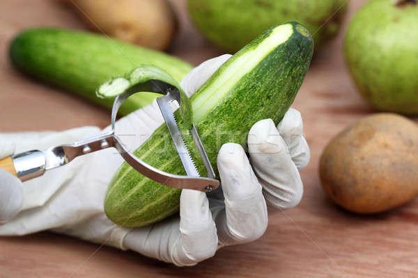 Peeling off cucumber Stock photo © bdspn