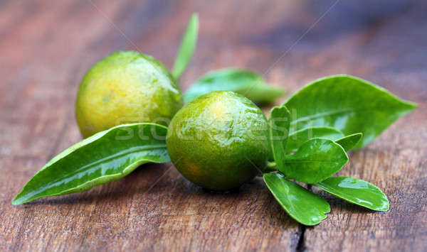 Fresh oranges with green leaves Stock photo © bdspn