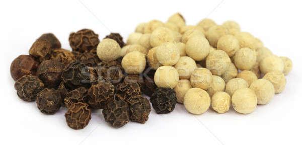 Black and white peppercorns Stock photo © bdspn