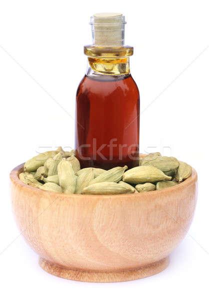 Kakule yağ beyaz şişe taze tohum Stok fotoğraf © bdspn