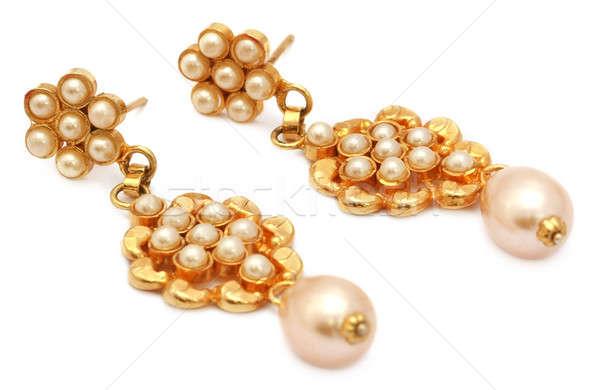 Fülbevalók arany gyöngyök pénz nők divat Stock fotó © bdspn