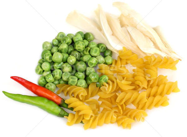 Frozen green peas with related snacks Stock photo © bdspn