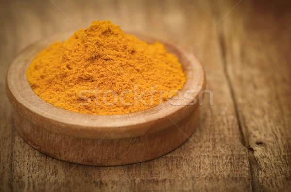 Ground turmeric in a bowl Stock photo © bdspn