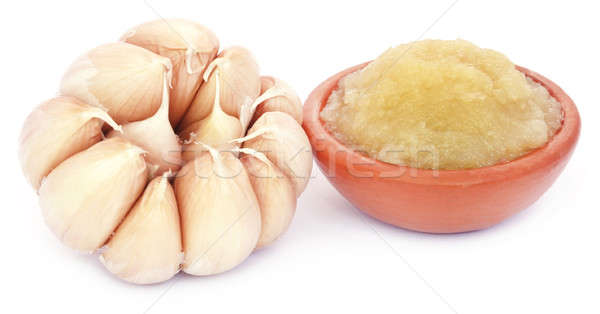 Crushed garlic with whole ones Stock photo © bdspn
