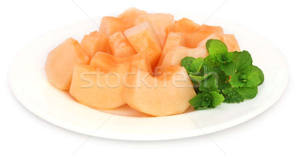 Muskmelon with mint leaves Stock photo © bdspn