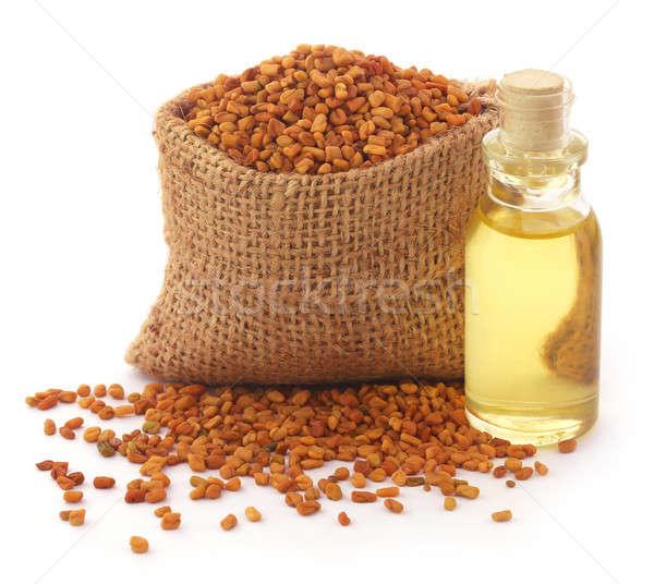Fenugreek with oil in bottle Stock photo © bdspn