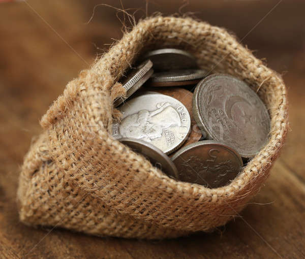 Old coins in sack bag Stock photo © bdspn
