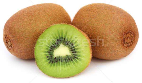 Kiwi frutas branco fruto fundo verde Foto stock © bdspn