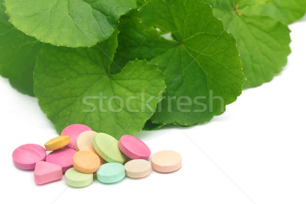 Medicinal thankuni leaves with pills Stock photo © bdspn