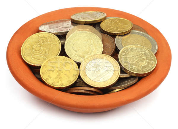 Coins in a bowl over white background Stock photo © bdspn