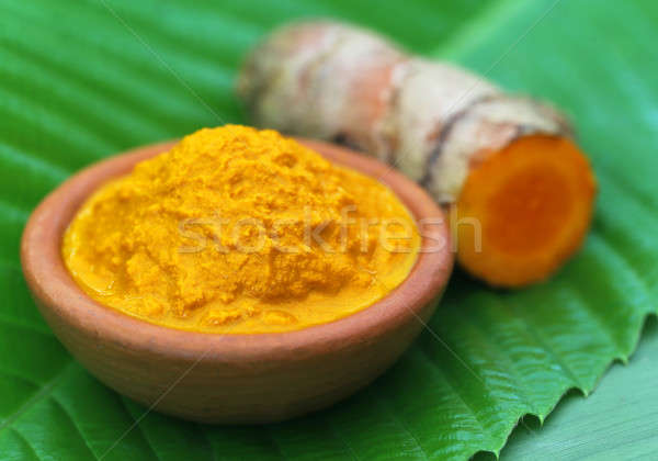 Mashed turmeric in a clay bowl Stock photo © bdspn