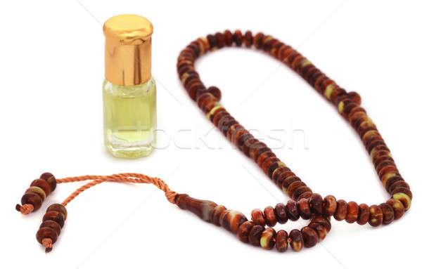 Różaniec perfum religijnych butelki kultu łańcucha Zdjęcia stock © bdspn