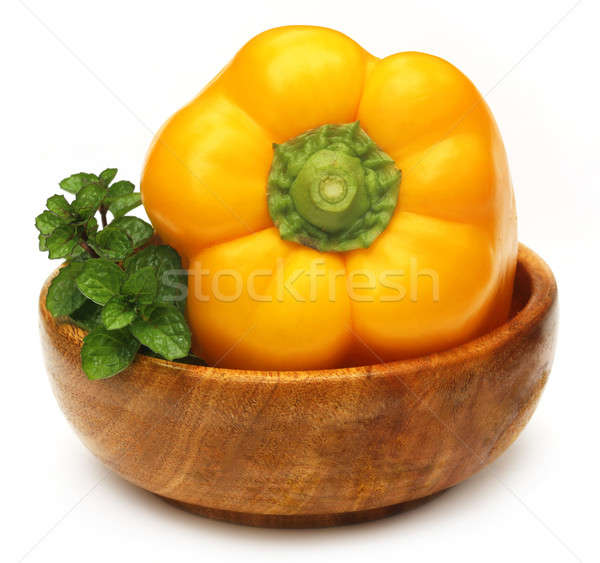 Yellow capsicum with mint leaves Stock photo © bdspn