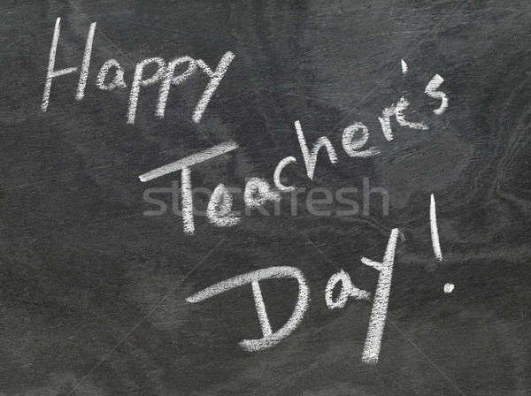 Happy Teachers Day written in chalkboard Stock photo © bdspn