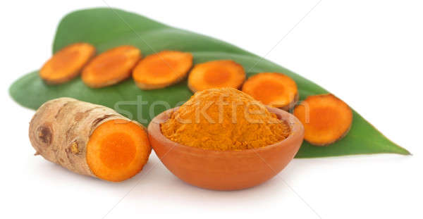Raw turmeric with green leaves Stock photo © bdspn