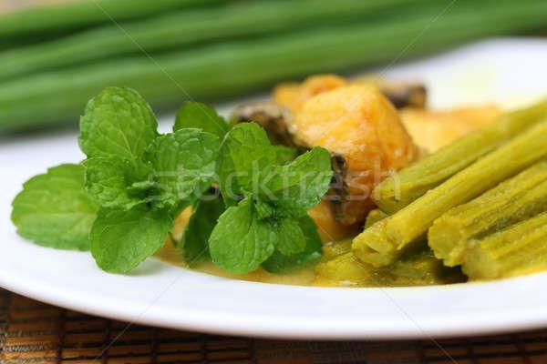 Moringa dish with fish and mint Stock photo © bdspn