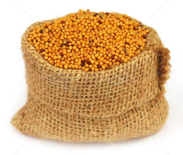 Golden Mustard in a sack bag Stock photo © bdspn