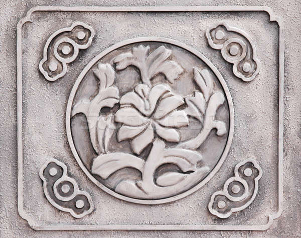 Flower engraved on stone Stock photo © bedo