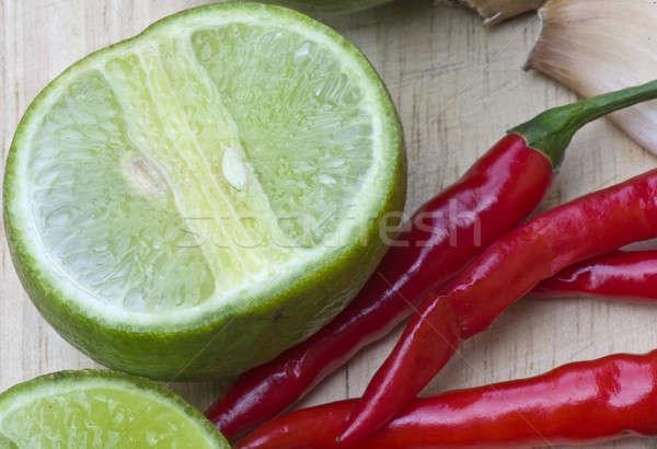 chili lemon and garlic ingredient for cooking Stock photo © beemanja