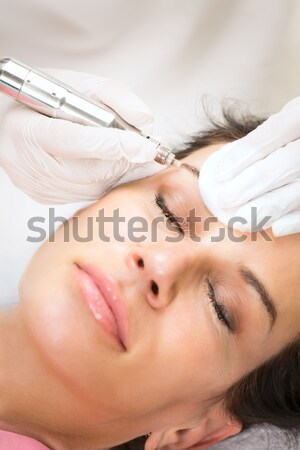 Beautiful woman having acupuncture.  Stock photo © belahoche