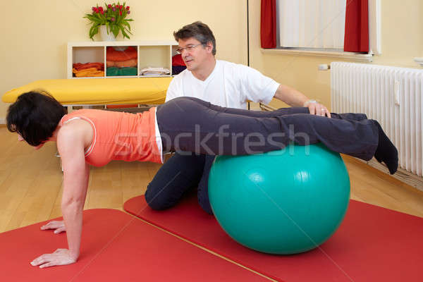 adult practicing poses on exercise ball Stock photo © belahoche
