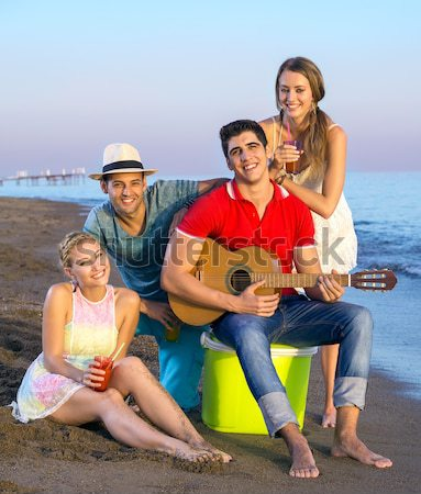 Two Happy Couples at the Beach on Sunset Stock photo © belahoche
