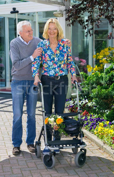 Senior Man Helping Woman with Walker Outdoors Stock photo © belahoche