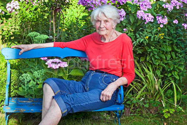 Old Woman Sitting on the Bench at the Garden Stock photo © belahoche