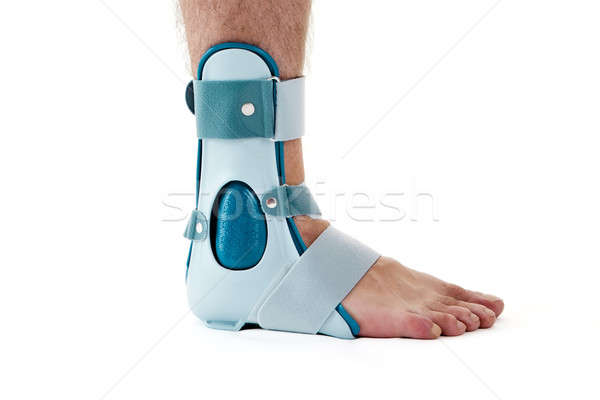Man Wearing Ankle Support Cast in White Studio Stock photo © belahoche