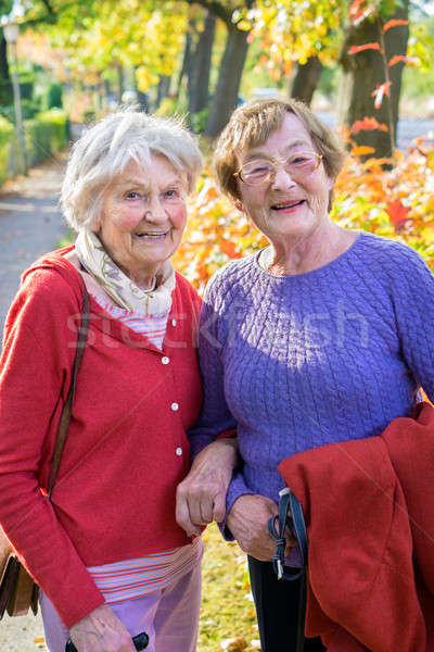 Two Smiling Senior Women in Autumn Outfits.  Stock photo © belahoche