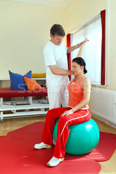 Physiotherapist Exercising With Patient Stock photo © belahoche