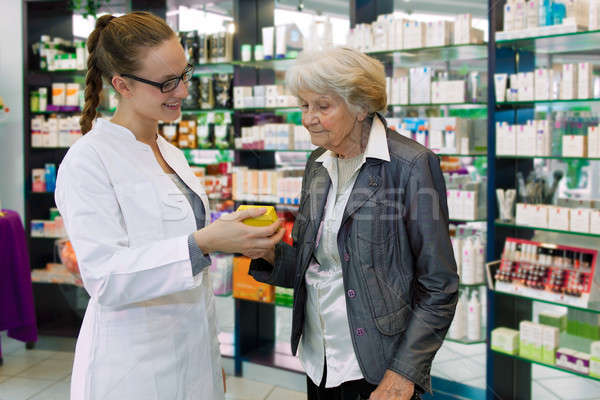 Pharmacist advising medication to senior patient Stock photo © belahoche
