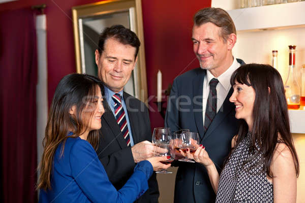 Business people at party. Stock photo © belahoche