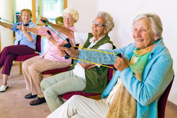 Derűs idős nők testmozgás karok csoport Stock fotó © belahoche