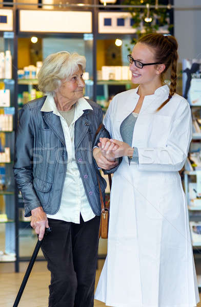 Stock photo: Young pharmacist and senior patient