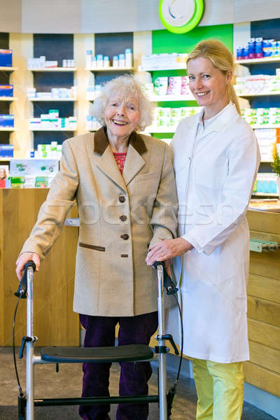 Joyful pharmacist and patient in walker Stock photo © belahoche