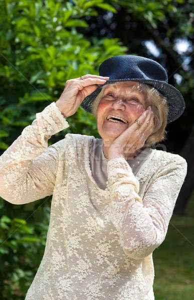 Vivacious elderly lady Stock photo © belahoche