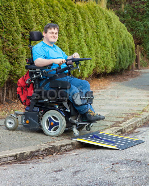 Young man with infantile cerebral palsy Stock photo © belahoche