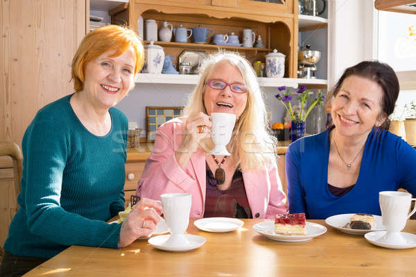 Smiling Mom Friends with Snacks Looking at Camera Stock photo © belahoche