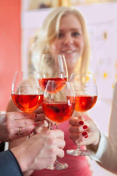 Stock photo: Hands Tossing Red Wine on Elegant Glasses