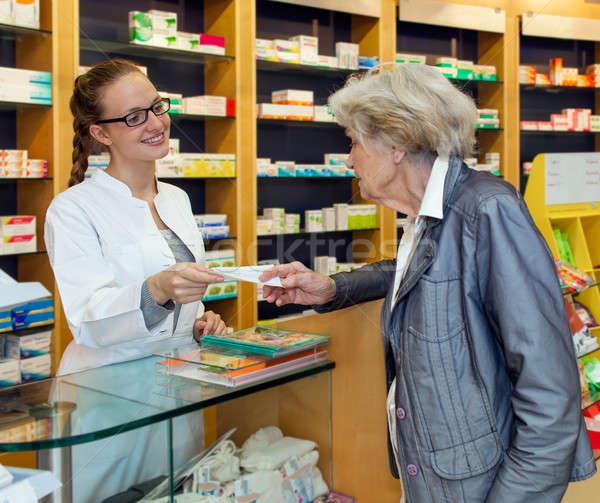 Pharmacist serving a senior lady Stock photo © belahoche