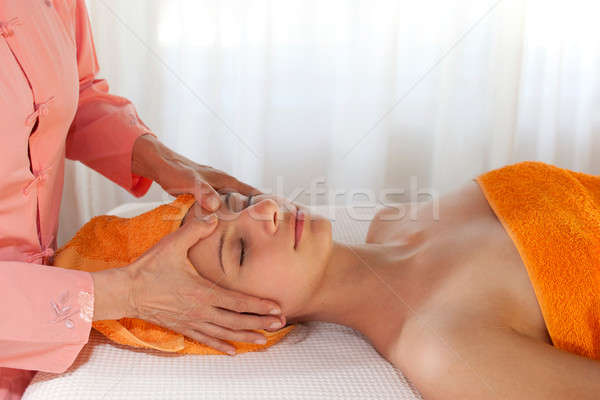 Beauty Therapist Giving Facial Massage Stock photo © belahoche