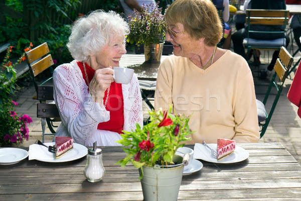 Two senior ladies enjoying outdoor refreshments. Stock photo © belahoche